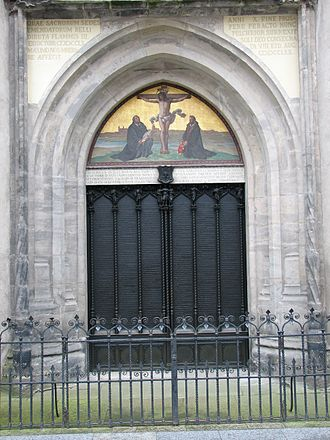 Luther's theses are engraved into the door of All Saints' Church, Wittenberg. The Latin inscription above informs the reader that the original door was destroyed by a fire, and that in 1857, King Frederick William IV of Prussia ordered a replacement be made.